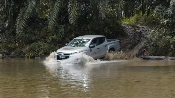 Mitsubishi Tritons are used to pave the way for gas pipeline works in Sarawak